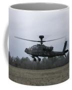 An Ah-64 Apache Helicopter In Midair Coffee Mug