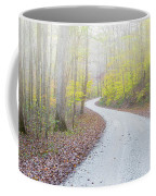 Road Passing Through A Forest Coffee Mug