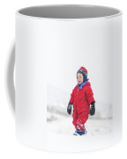 A Two Year Old Boy Plays In A Snowy Coffee Mug