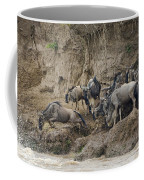Wildebeests Crossing Mara River, Kenya Coffee Mug