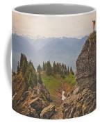 A Backpacker Balances On The Blocky Coffee Mug