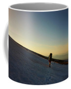 A Backpacker Crosses A Snowfield On Mt Coffee Mug