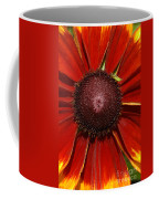A Big Orange And Yellow Flower Coffee Mug