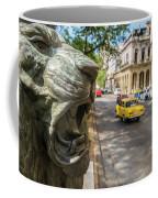 A Bronze Lion Guards Historic Buildings Coffee Mug