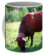 A Bull  Grazing On The Meadow Coffee Mug