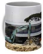 A Bulldozer Moving Dug Out Concrete And Fresh Earth Below The Concrete Coffee Mug