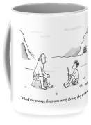 A Cave Dweller Speaks To His Son Who Is Holding Coffee Mug