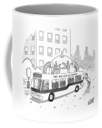 A City Bus Is Seen With A Rooftop Bubble Coffee Mug
