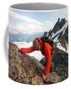 A Climber Scrambles Up A Rocky Mountain Coffee Mug
