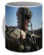A Coalition Force Member Sets Coffee Mug