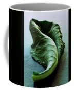 A Collard Leaf Coffee Mug by Romulo Yanes