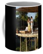 A Couple Having Drinks On A Deck Coffee Mug