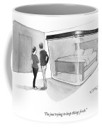 A Couple Looks At A Bed Encased In A Giant Coffee Mug