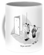 A Couple Looks Disapprovingly At An Apartment Coffee Mug