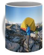 A Couple Of Backpackers Carry Coffee Mug