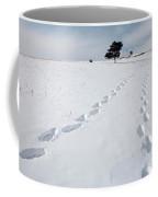 A Couple Walking In The Snow Coffee Mug