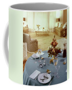 A Dining Room With A Blue Tablecloth And Ornate Coffee Mug