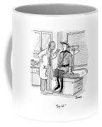 A Doctor Inspects A Royal Canadian Mounted Coffee Mug