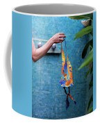 A Female Hand Holding A Bathing Suit Coffee Mug