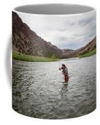 A Fly Fisherman Mends While Fishing Coffee Mug
