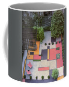 A Garden With Colourful Landscaping In Dr Coffee Mug
