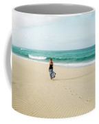 A Girl Walks On The Beach In A Long Coffee Mug
