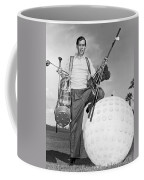 A Golfer With A Giant Ball Coffee Mug