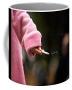 A Hand Holding A Cigarette Coffee Mug