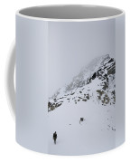 A Hiker Approaches A Snowy Peak Covered Coffee Mug