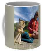 A Hiker Makes Friends With The Local Coffee Mug