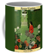 A House And Garden Cover Of A Woman Raking Leaves Coffee Mug