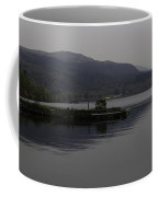 A Jetty Pushing Out Into The Waters Of Loch Ness In Scotland Coffee Mug