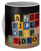 A Jug Fills Drop By Drop Coffee Mug