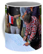 A Lady Signs Petition At May Day Rally Singapore Coffee Mug