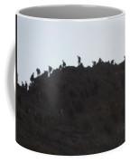 A Line Of People Walking On A Mountain Coffee Mug