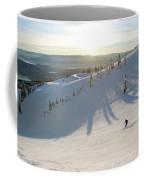 A Lone Skier Makes A Turn At Whitefish Coffee Mug