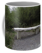 A Long Stone Section Over Wooden Stumps Forming A Rough Sitting Area Coffee Mug
