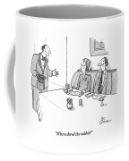 A Magician Is Seen Speaking To Two People Seated Coffee Mug