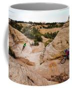 A Male And Female Mountain Biker Ride Coffee Mug