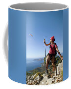 A Male Climber Looking At Paragliding Coffee Mug