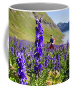 A Male Hiker In Sunny Flower Field Coffee Mug