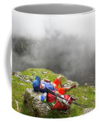 A Male Hiker Is Resting In A Grassy Coffee Mug