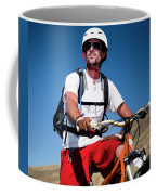 A Male Mountain Biker Stops To Enjoy Coffee Mug