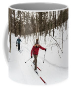 A Man And Woman Cross Country Skiing Coffee Mug