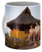 A Man And Woman Enjoy Sunset Coffee Mug