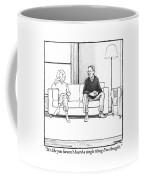 A Man And Woman Sit Next To Each Other On A Couch Coffee Mug