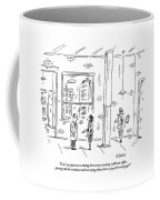 A Man And Woman Stand Inside An Empty Property Coffee Mug