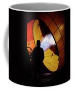 A Man As He Inflates A Hot Air Balloon Coffee Mug