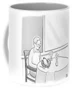 A Man At A Restaurants Looks At The Fish Coffee Mug