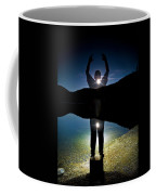 A Man Balances On A Log At Night Coffee Mug